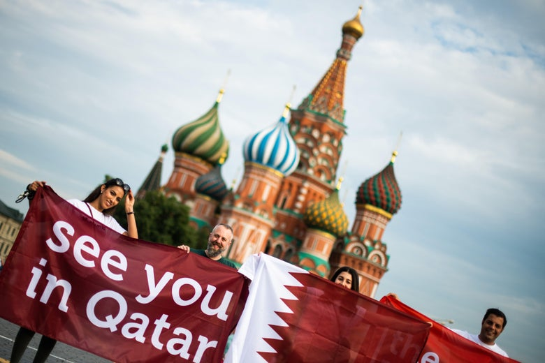A group of people display a banner reading 'See you in Qatar' in reference to the Qatar 2022 World Cup at the Red Square in Moscow on July 14, 2018 on the eve of the Russia 2018 World Cup final football match between France and Croatia. (Photo by Jewel SAMAD / AFP)        (Photo credit should read JEWEL SAMAD/AFP/Getty Images)