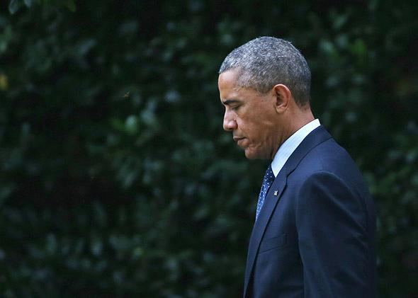 President Obama walks toward Marine One while departing the White House.