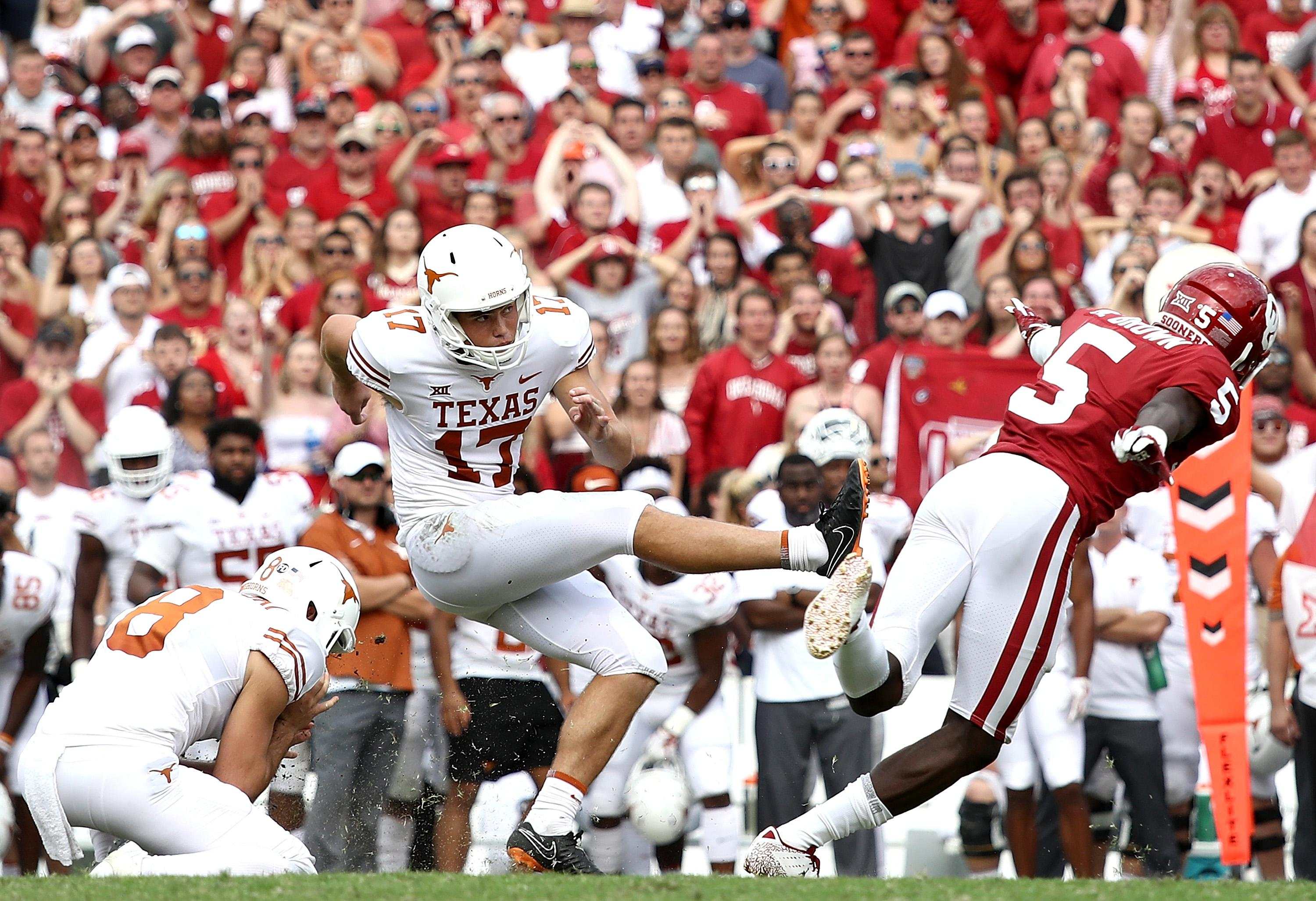DALLAS, TX - OCTOBER 06:  Cameron Dicker #17 of the Texas Longhorns kicks the game winning field goal against the Oklahoma Sooners in the 2018 AT&T Red River Showdown at Cotton Bowl on October 6, 2018 in Dallas, Texas.  (Photo by Ronald Martinez/Getty Images)