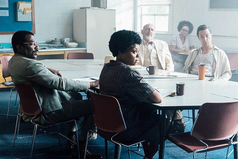 Taraji P. Henson and Sam Rockwell and other actors sit around a table in a still from The Best of Enemies.