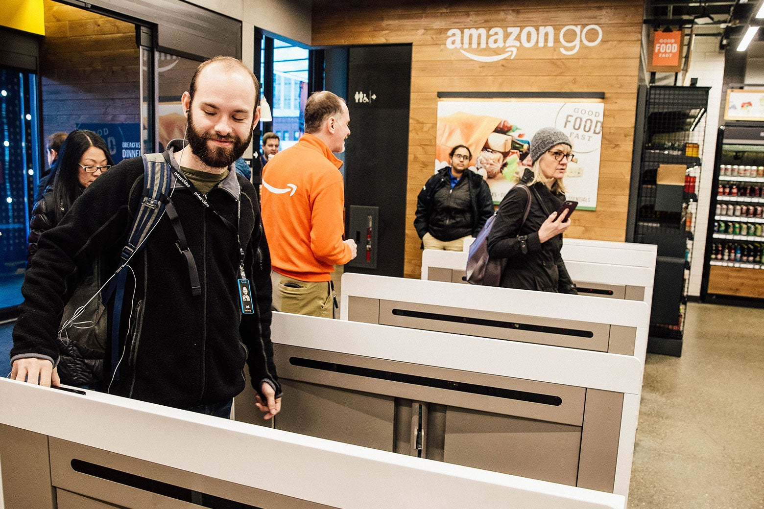 Shoppers scan the Amazon Go app on their mobile devices as they enter the Amazon Go store on Jan. 22 in Seattle.