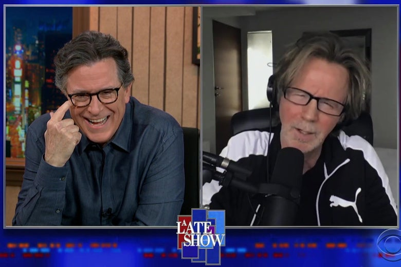 A split screen showing Stephen COlbert in one view, laughing, and Dana Carvey, in a black and white Puma track suit, impersonating Joe Biden.