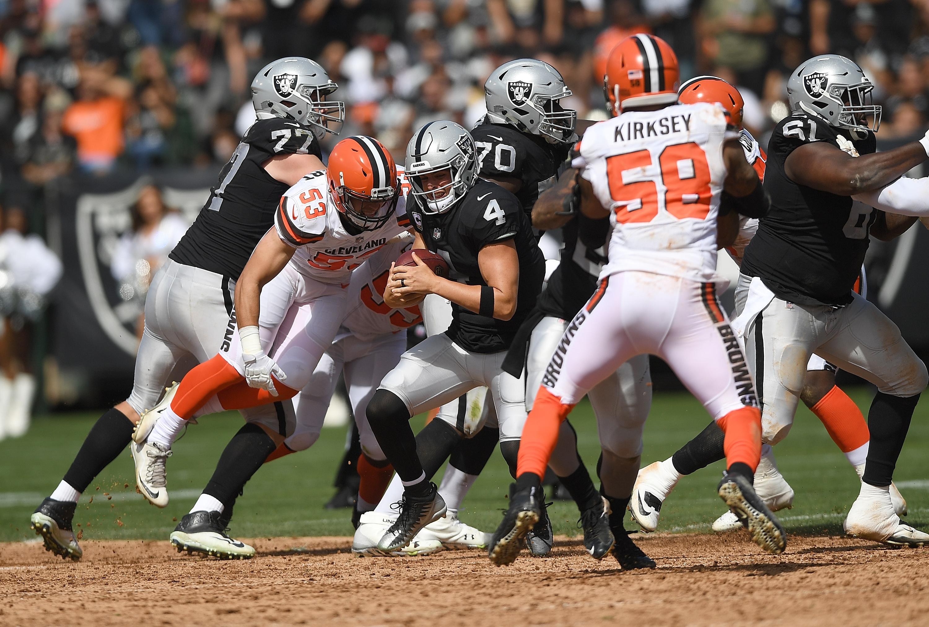 OAKLAND, CA - SEPTEMBER 30:  Joe Schobert #53 of the Cleveland Browns sacks quarterback Derek Carr #4 of the Oakland Raiders during the second quarter of their NFL football game at Oakland-Alameda County Coliseum on September 30, 2018 in Oakland, California.  (Photo by Thearon W. Henderson/Getty Images)