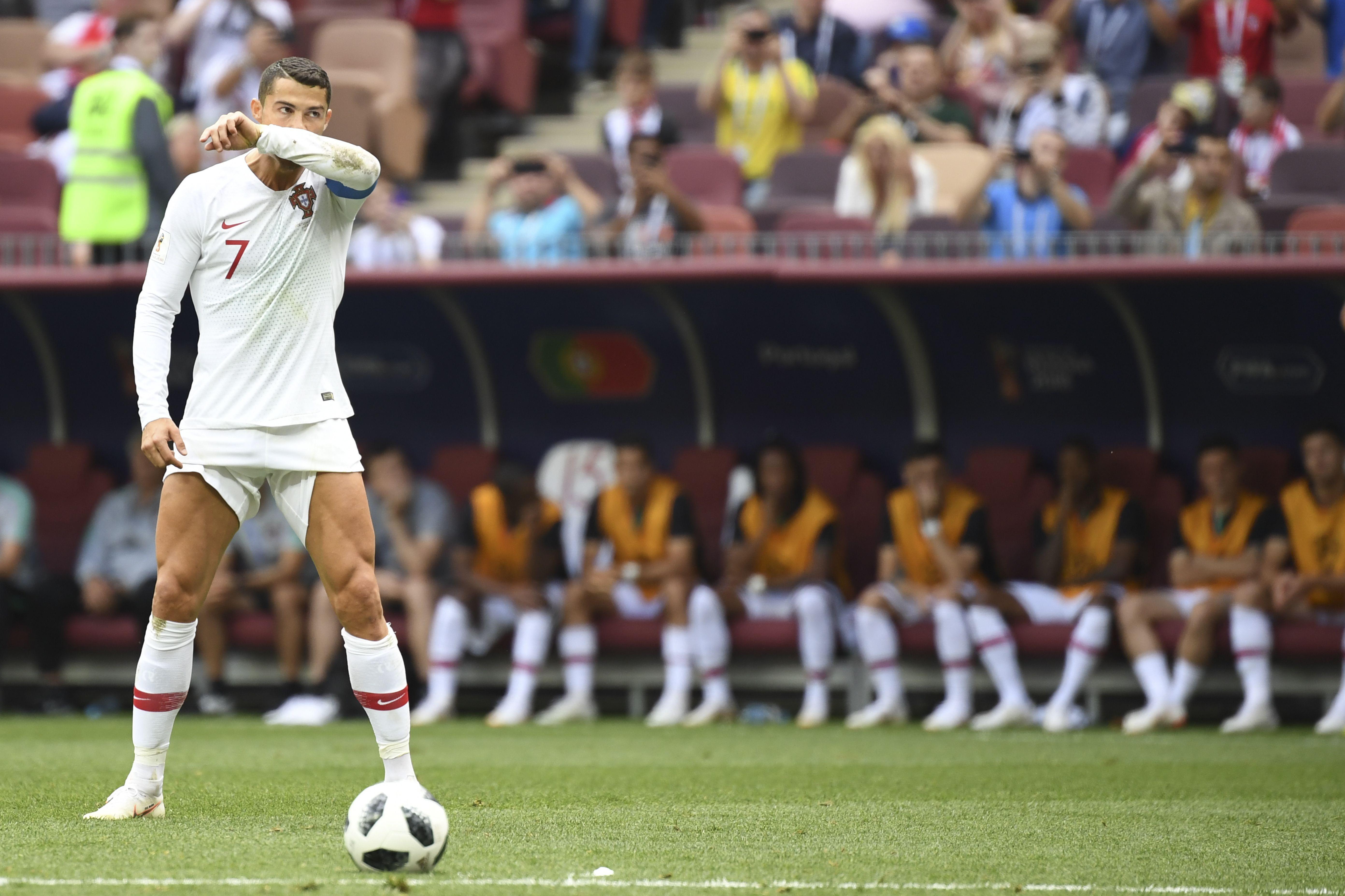 Portugal's forward Cristiano Ronaldo prepares to shoot a free kick.