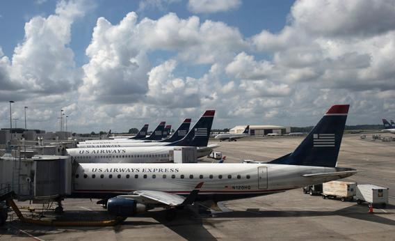 U.S. Airways planes lined up at a passenger terminal at the Charlotte Douglas International Airport in Charlotte, N.C., July 15, 2012.