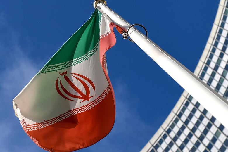 The Iranian national flag is seen outside the International Atomic Energy Agency (IAEA) headquarters during the agency's Board of Governors meeting in Vienna on March 1, 2021.