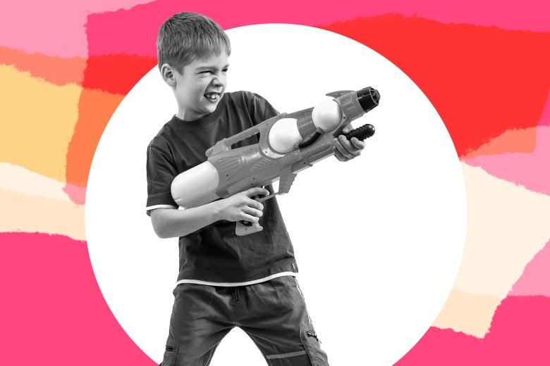 A boy shoots a water gun.