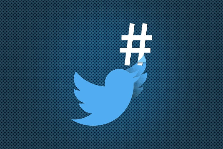 A Twitter bird is seen flying near a hashtag symbol.