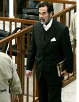Saddam Hussein in suit, minus tie         Click image to expand.