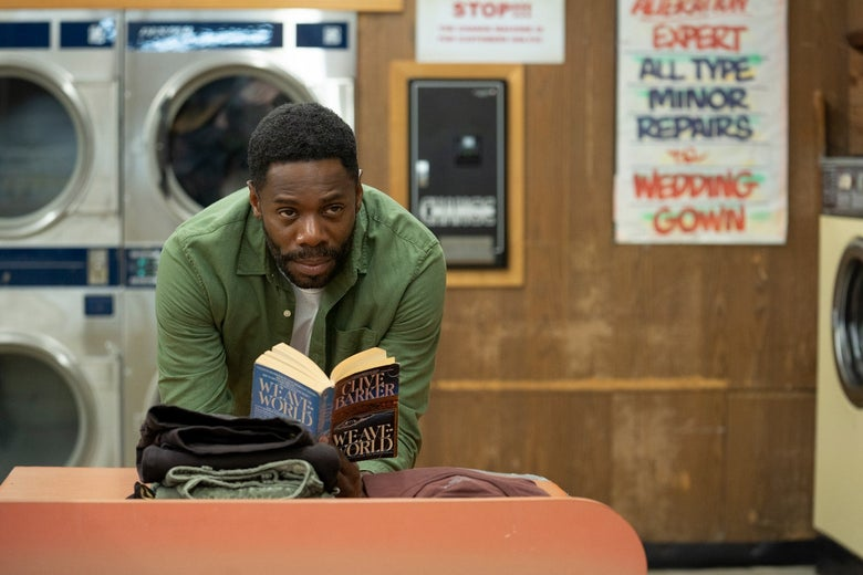 In a laundromat, Colman Domingo reads Clive Barker's Weave World.