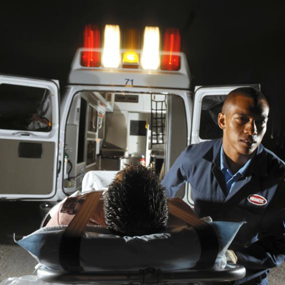 An EMT helping a patient.