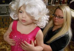 "Madisyn ""Maddy"" Verst, left, dresses up for the TLC show ""Toddlers and Tiaras""."