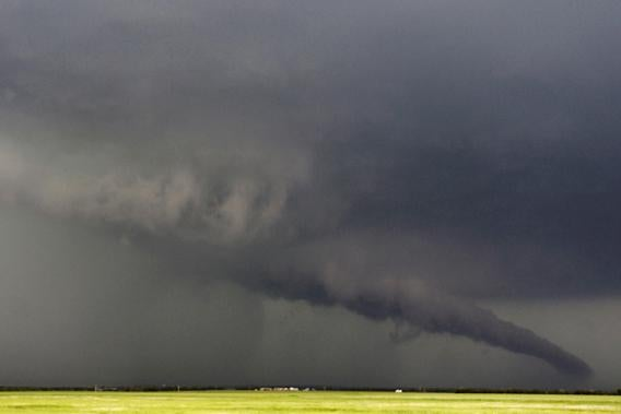 The funnel of a tornadic thunderstorm almost touches the ground near South Haven, in Kansas May 19, 2013.
