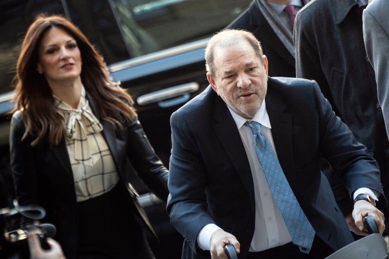 Weinstein's lawyer, left, and Weinstein, right, walk toward the camera. Weinstein is leaning on a walker.