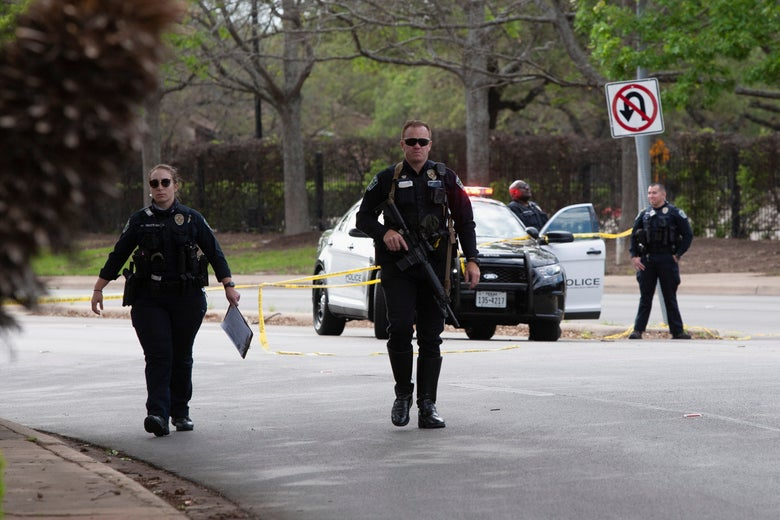 Austin police officers investigate at the scene of a deadly shooting at an apartment complex in Austin, Texas, on April 18, 2021.