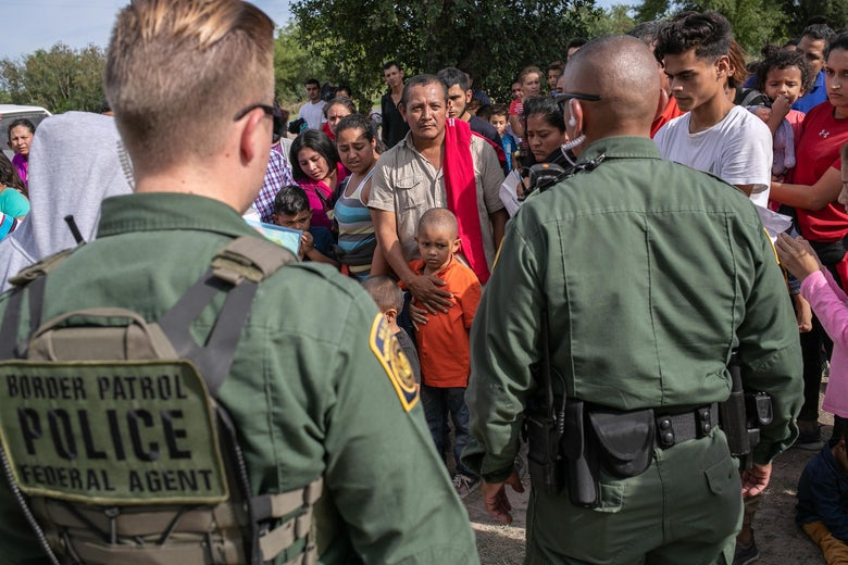 U.S. Border Patrol agents take immigrants into custody on July 02, 2019 in Los Ebanos, Texas.