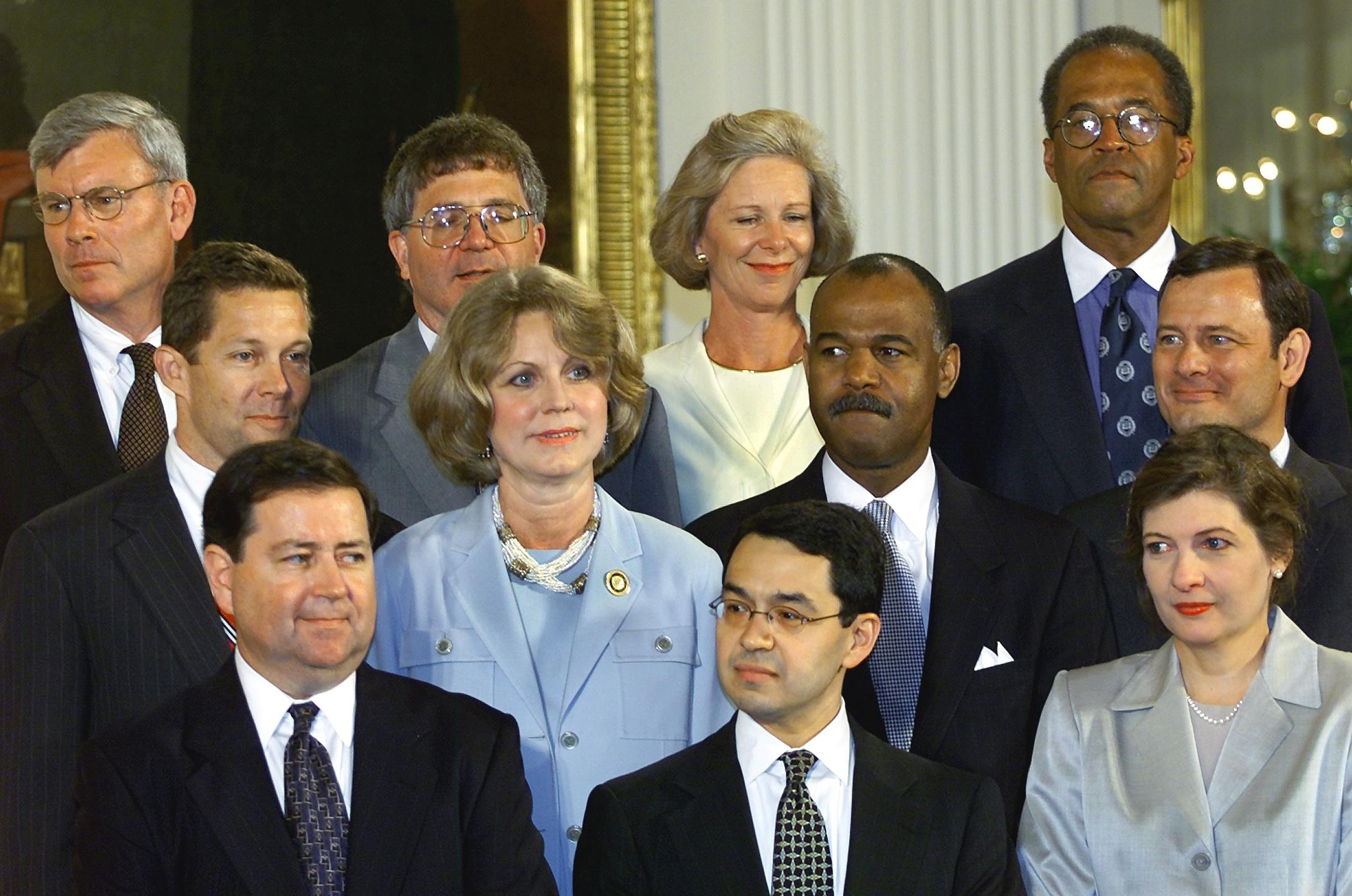 Judge Edith Brown Clement (middle row, second from the left). Spot a young John Roberts on the right.