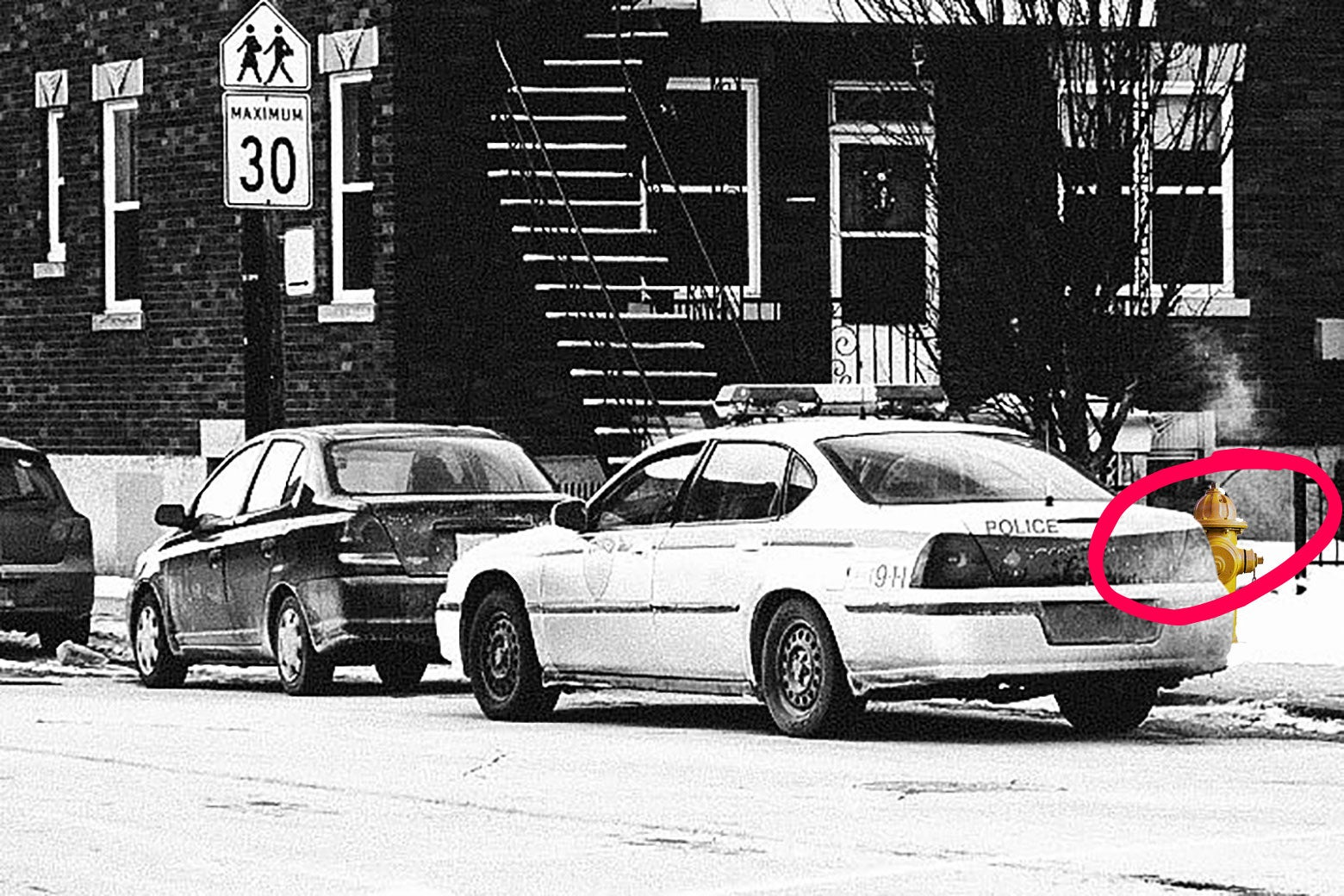 Photo illustration: a police car is illegally parked in front of a fire hydrant that is circled. Photo illustration by Slate. Photos by Thinkstock.
