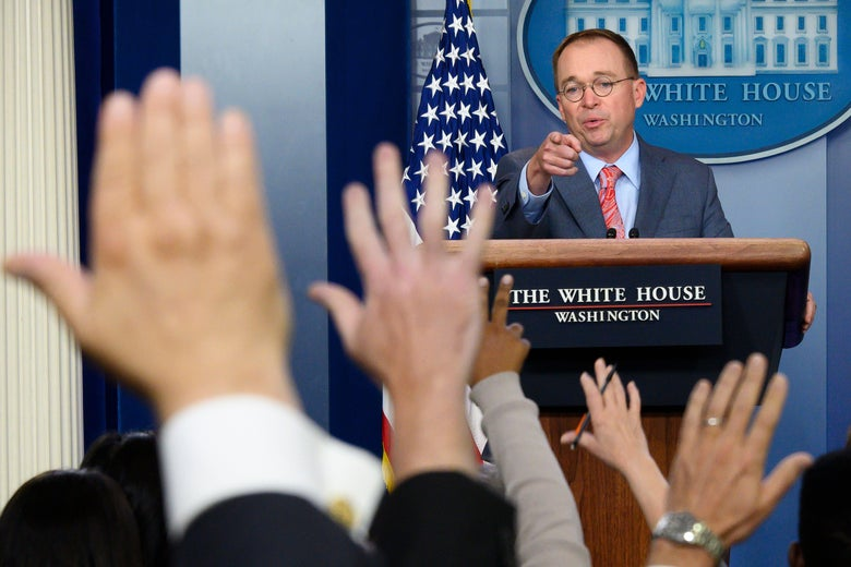 Mick Mulvaney answers questions from reporters.