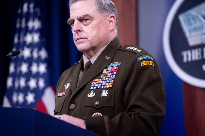 Mark Milley in military uniform speaking into a mic