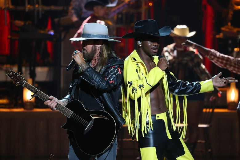 Billy Ray Cyrus (L) and Lil Nas X perform onstage during the 2019 BET awards at Microsoft Theater in Los Angeles, California on June 23, 2019. (Photo by Jean-Baptiste LACROIX / AFP)        (Photo credit should read JEAN-BAPTISTE LACROIX/AFP/Getty Images)