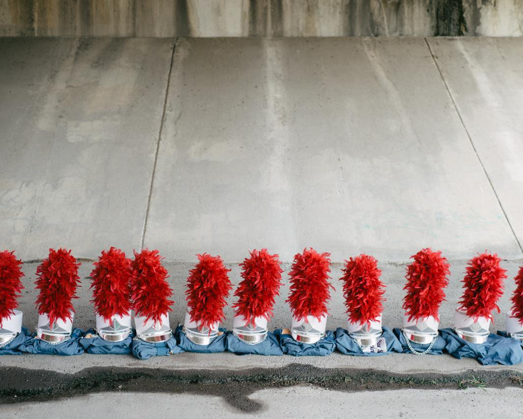 Blue Stars Uniforms. Uniforms are lined up beneath an overpass during warmups for the DCI Southwestern Championship, Blue Stars Drum & Bugle Corps, The Alamodome, San Antonio, Texas