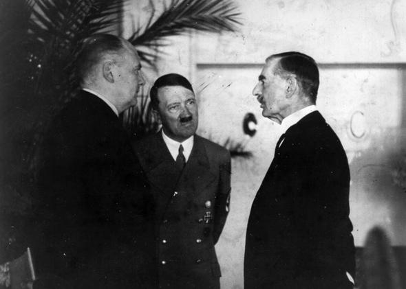 Hitler's interpreter Paul Schmidt conveying the Fuhrer's reply to a question from Neville Chamberlain during their meeting at the Hotel Dreesen at Godesberg.,96d/26/inns/4433/15