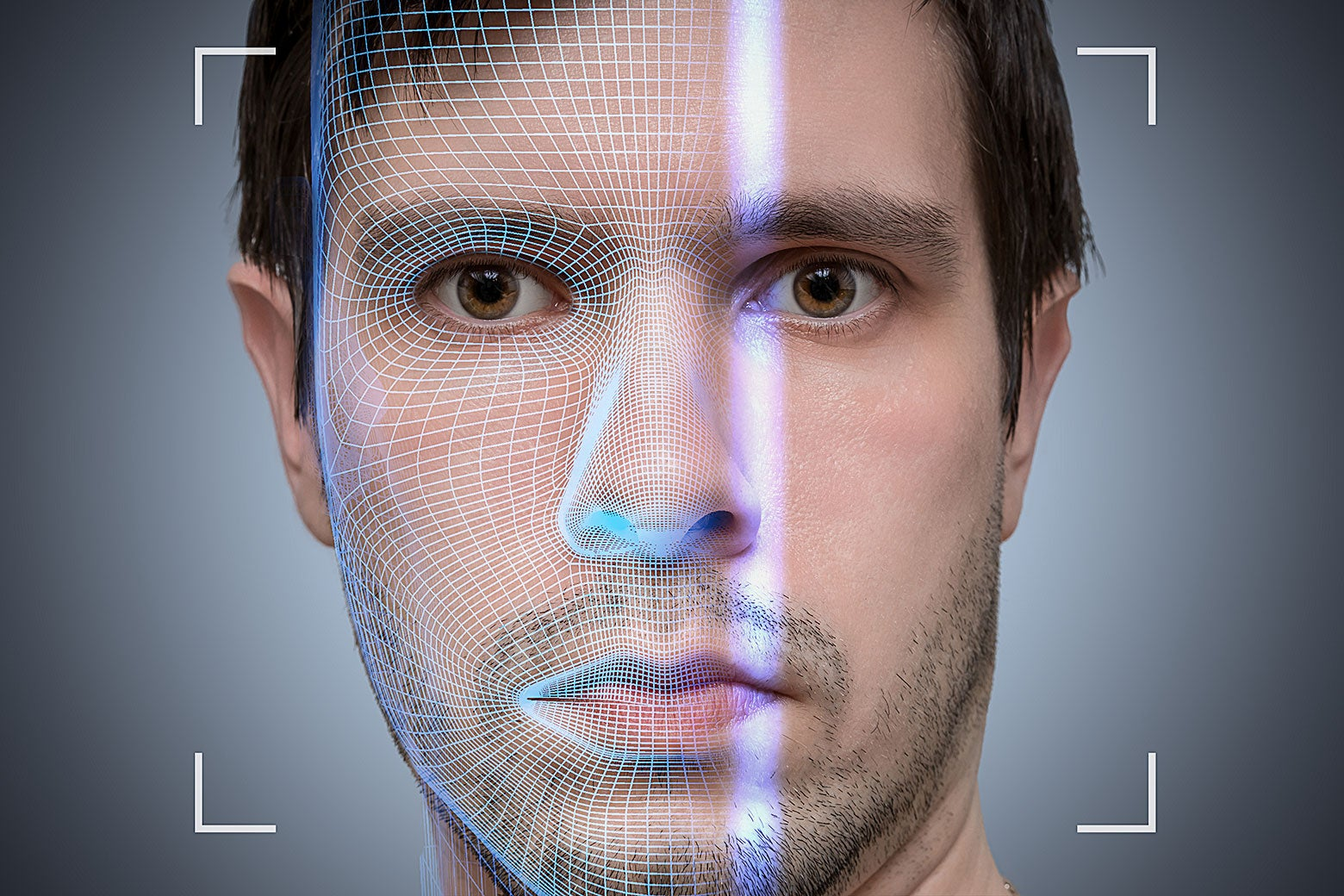 A face of a young man being biometrically scanned.