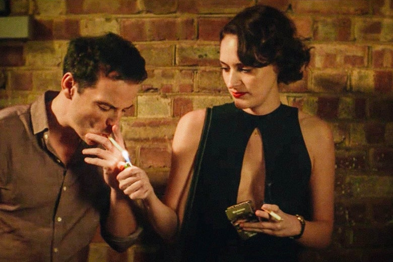 Phoebe Waller-Bridge lights a man's cigarette in a still from Fleabag.