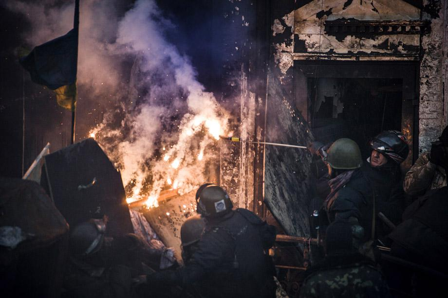 Demonstrators clash with riot police in central Kiev on Feb. 18, 2014.