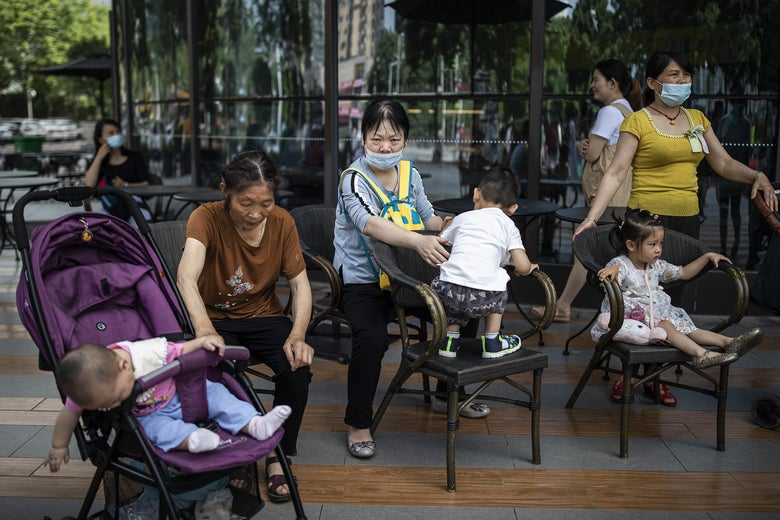 People tend to their children at a community square on May 31, 2021 in Wuhan, China.