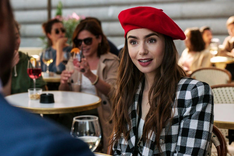 Lily Collins in a still from Emily in Paris wearing a red beret.