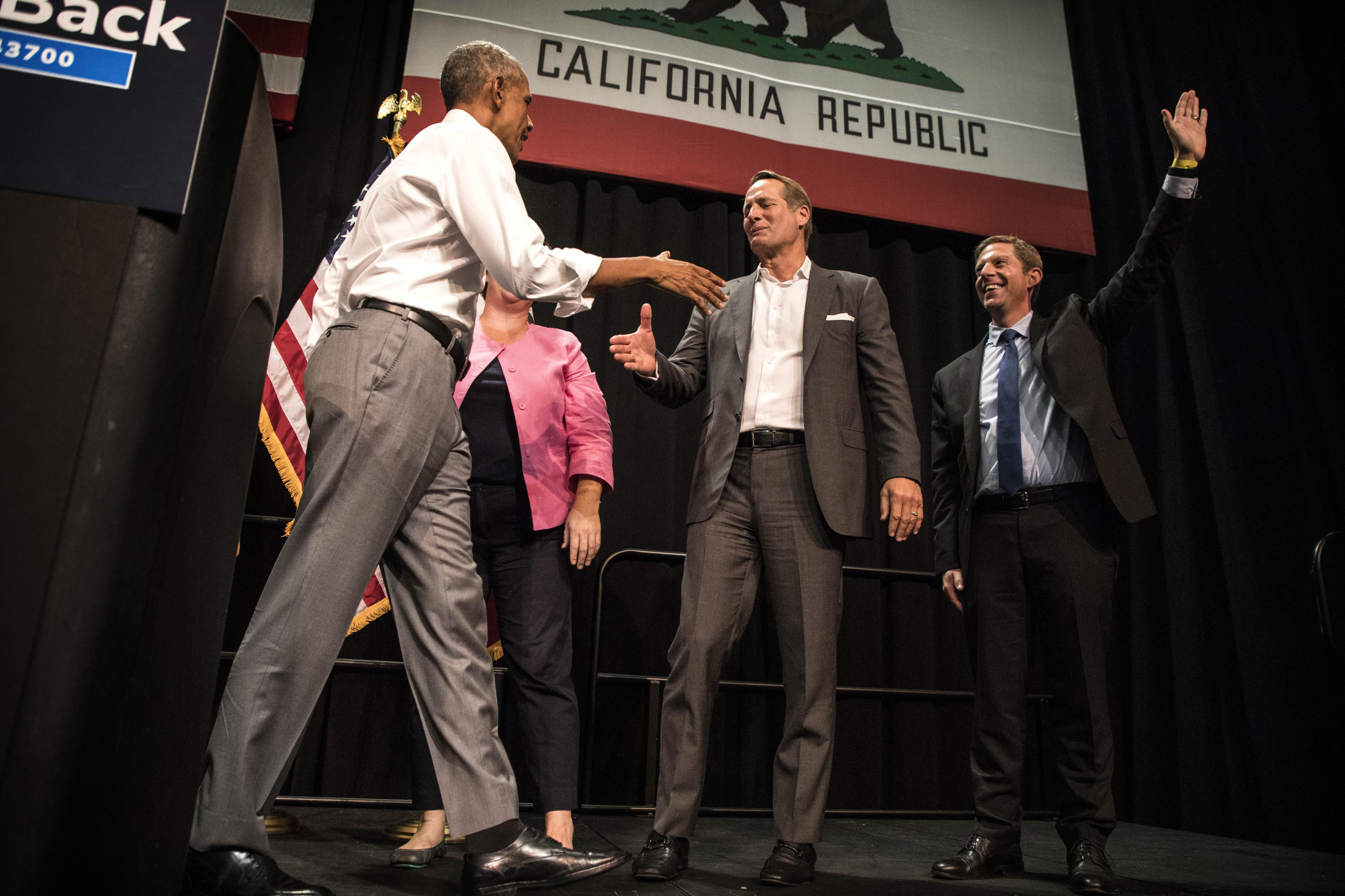 President Barack Obama shakes hands with Katie Porter (CA-45), Harley Rouda (CA-48), and Mike Levin (CA-49) following a DCCC rally on Saturday in Anaheim, California.