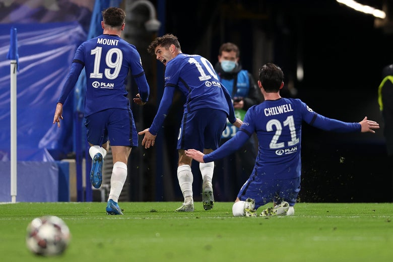 Mason Mount of Chelsea celebrates with teammates Christian Pulisic and Ben Chilwell after scoring against Real Madrid.