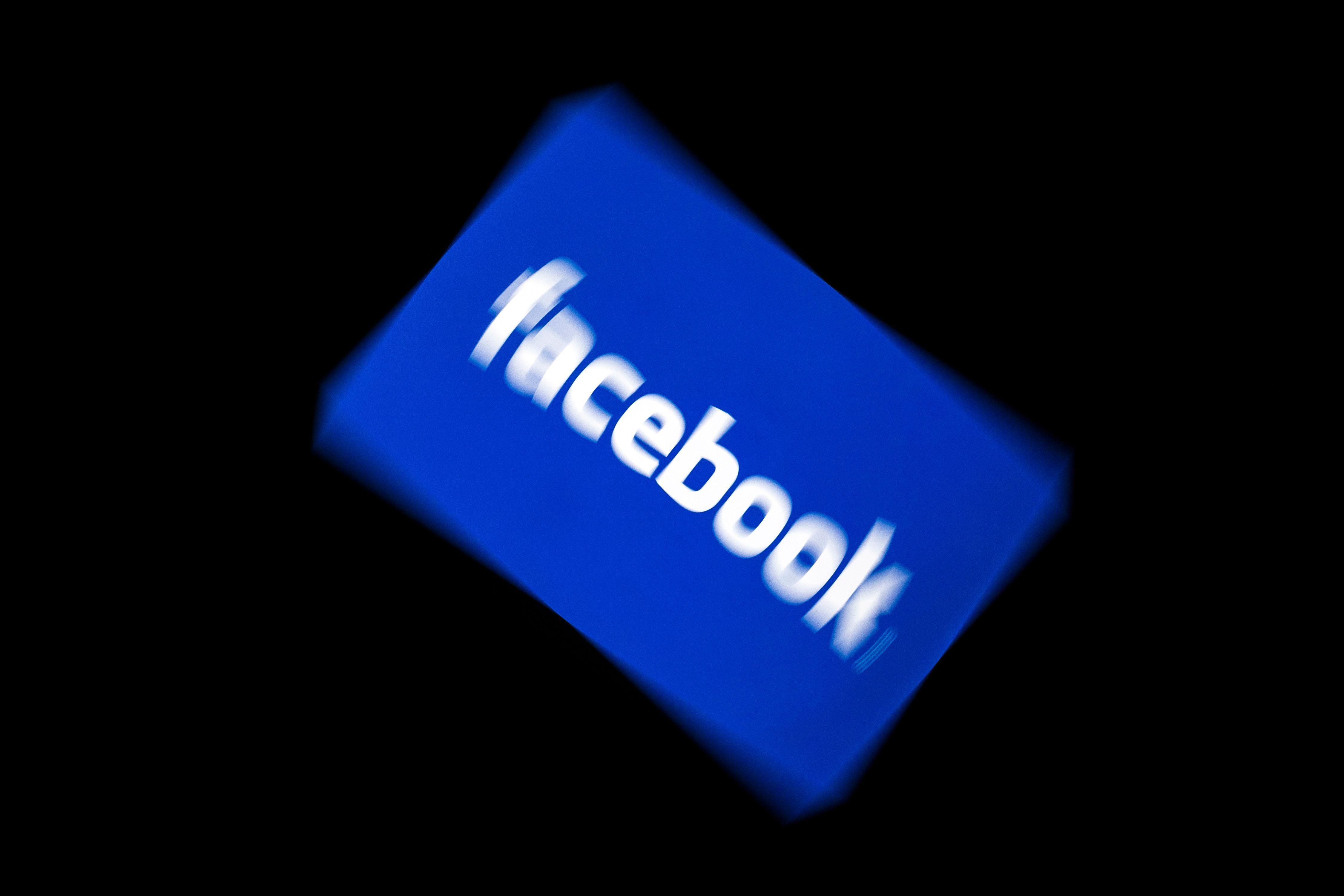 Facebook logo displayed on a tablet.