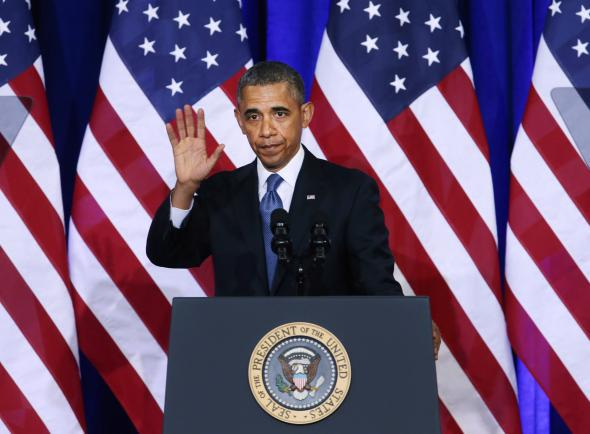 President Obama waves after speaking about the National Security Agency (NSA).