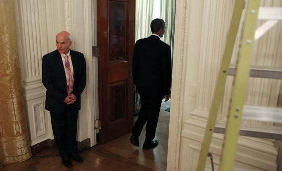 Obama leaves the East Room after his press conference and shuts the door on a carbon tax.