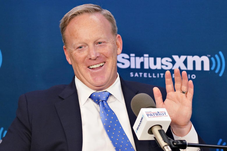 Sean Spicer speaks into a microphone.