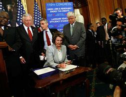 House Speaker Nancy Pelosi signs the HR1424 Financial Rescue package bill. Click image to expand.