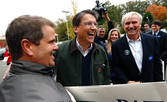 North Carolina Governor Pat McCrory meets supporters outside Myers Park Traditional Elementary school during the U.S. presidential election in Charlotte.