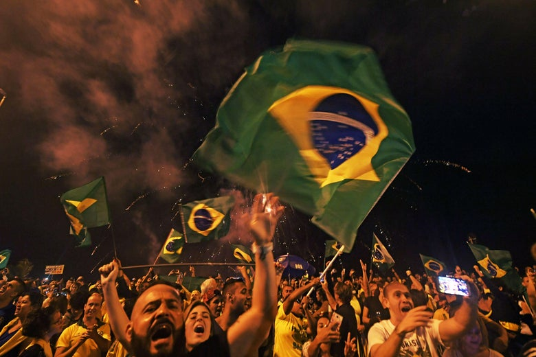 Supporters of far-right lawmaker and presidential candidate for the Social Liberal Party (PSL), Jair Bolsonaro, celebrate in Rio de Janeiro, after the former army captain won Brazil's presidential election on October 28, 2018.