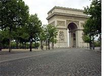 The Arc de Triomphe is clear of traffic only early in the morning