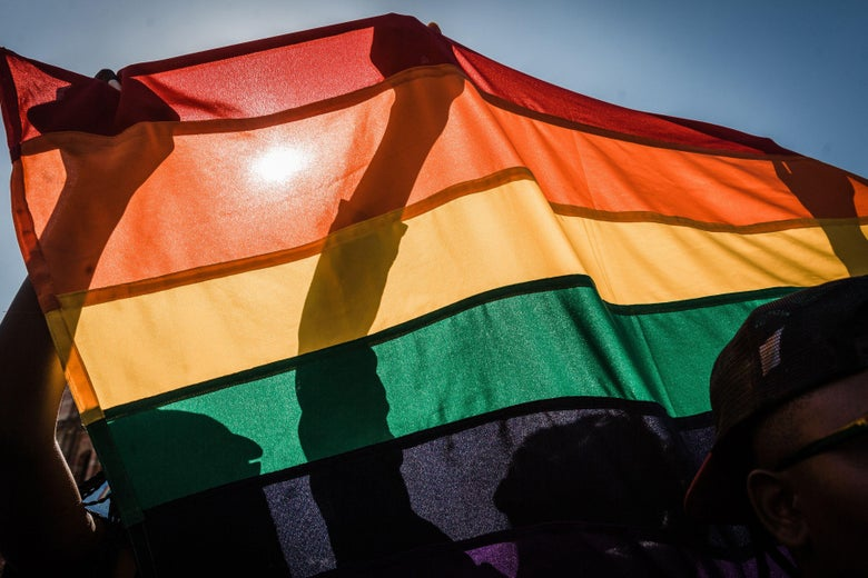 People with a rainbow flag take part in the annual Gay Pride Parade on June 30, 2018 in Durban, South Africa.