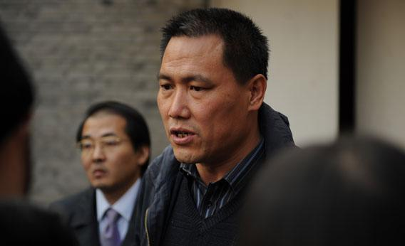 Pu Zhiqiang (center), the lawyer for Chinese artist Ai Weiwei