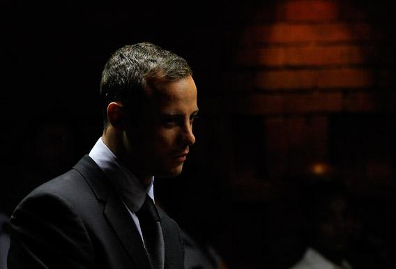 Oscar Pistorius stands in the dock ahead of court proceedings at the Pretoria magistrates court.