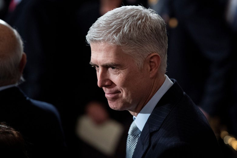 Supreme Court Justice Neil Gorsuch waits on Capitol Hill on Dec. 3.
