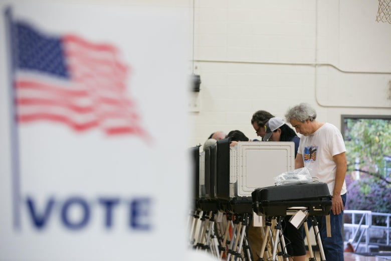 Voters cast their ballots at a polling station set up at Grady High School for the midterm elections on Nov. 6, 2018 in Atlanta, Georgia.
