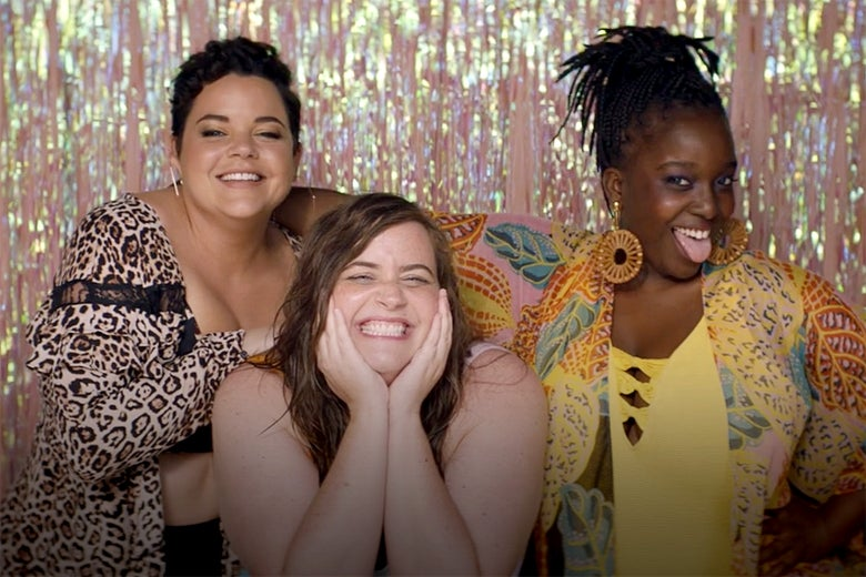 Melanie Field, Aidy Bryant, and Lolly Adefope pose as if for a photo booth.