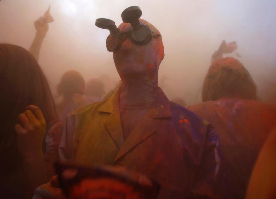 Participants dance and throw colored chalk during the Holi Festival of Colors at the Sri Sri Radha Krishna Temple in Spanish Fork, Utah on March 30, 2013.
