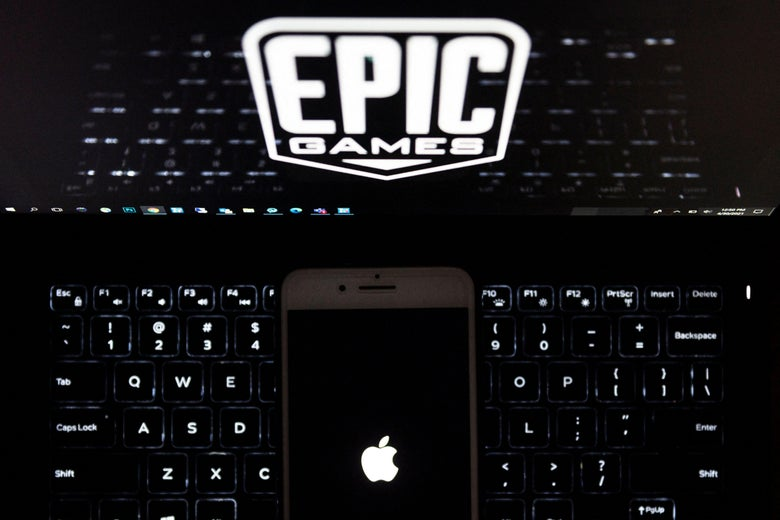 This illustration picture shows the logo from Epic Games displayed on a laptop and an Apple Logo on an iPhone in Arlington, Virginia on April 30, 2021. - In a court clash with potentially huge repercussions for the world of mobile tech, Fortnite maker Epic Games takes on Apple starting on May 3, 2021, aiming to break the grip of the iPhone maker on its online marketplace. - RESTRICTED TO EDITORIAL USE (Photo by Andrew CABALLERO-REYNOLDS / AFP) / RESTRICTED TO EDITORIAL USE (Photo by ANDREW CABALLERO-REYNOLDS/AFP via Getty Images)